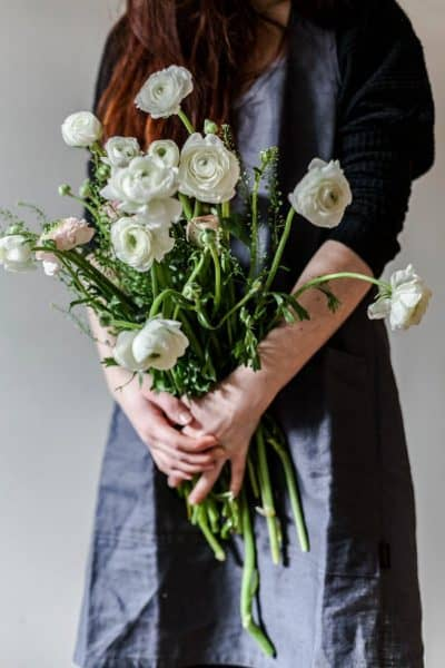 image of woman holding roses indoors how to care for roses indoors