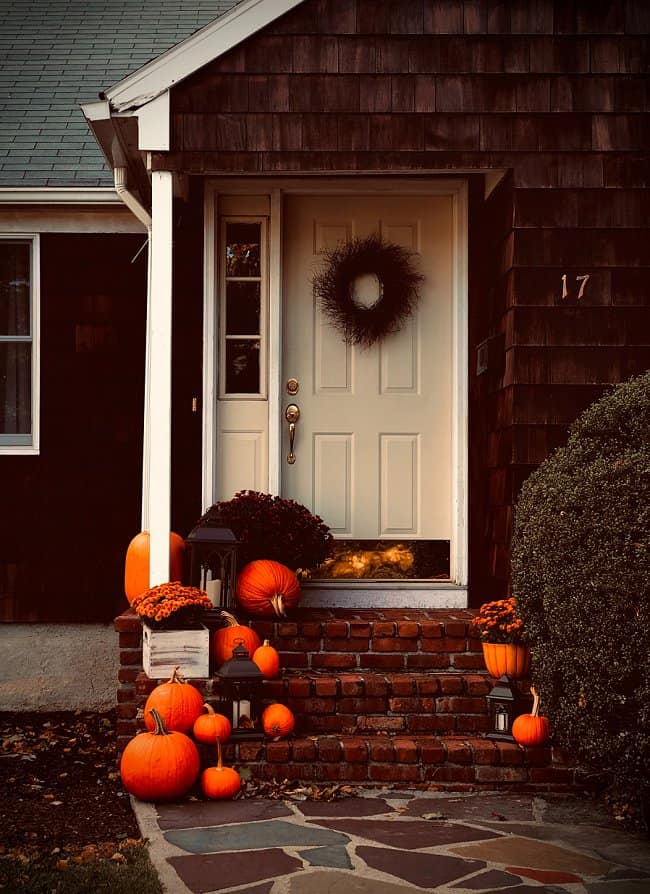 image of fall decorated front door with a wreath