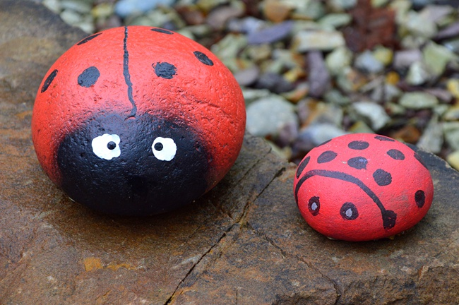 image of painted ladybirds kids art to to outside on patio