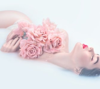 image of woman in bath with roses best organic rose water brand