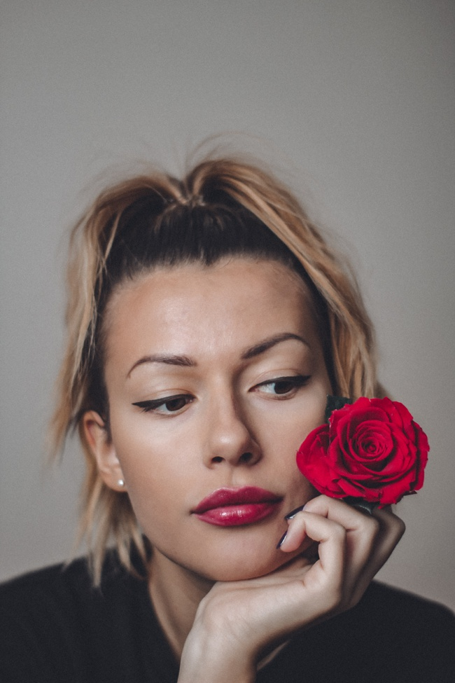 image of woman with rose rose water spray skin